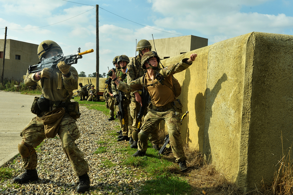 Paratroopers launch an assault on a compound
