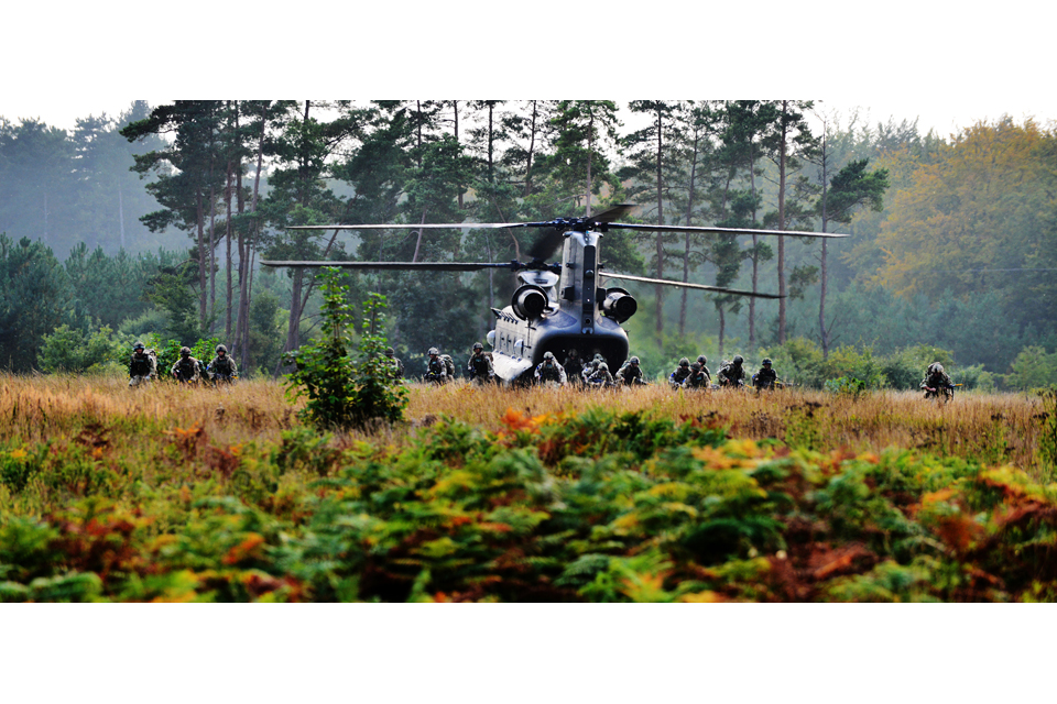 Paratroopers dismount from a Chinook helicopter