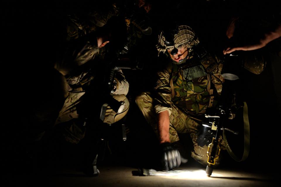 Lieutenant Tom Glinn briefs his men during a night operation