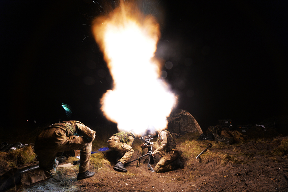 Paratroopers fire an 80mm mortar round
