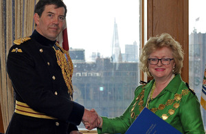 The Deputy Commander of the Army's London District, Brigadier Matthew Lowe, and the Lord Mayor of Westminster, Councillor Angela Harvey, at the Armed Forces Community Covenant signing in City Hall