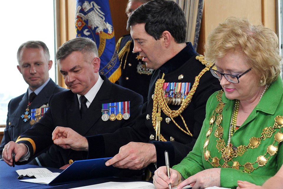 The Lord Mayor of Westminster, Councillor Angela Harvey, signs the Armed Forces Community Covenant for Westminster City Council