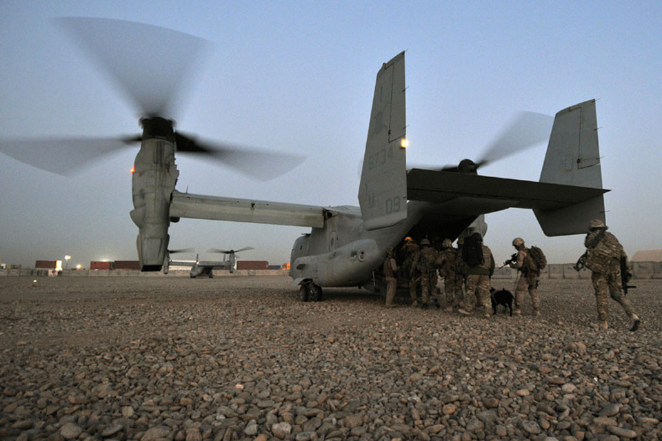 Sunrise, 6 Feb 2012: members of 2 Squadron RAF Regiment and the US Marine Corps board a US Osprey aircraft at Camp Bastion, Afghanistan