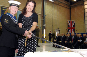 AET Charlotte Cole, of the Mobile Aircraft Support Unit (left), and Mrs Joanne Osmond, wife of CO Fleet Forward Support (Air) mark the opening of the refurbished Unicorn building.