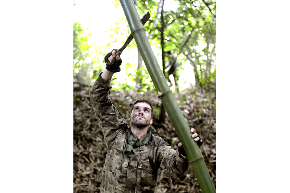 A Royal Marines commando cuts bamboo