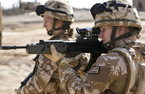 Two female British Service personnel, serving in a CIMIC (Civil-Military Co-operation) role, on patrol in Lashkar Gah, Helmand province, southern Afghanistan (stock image)
