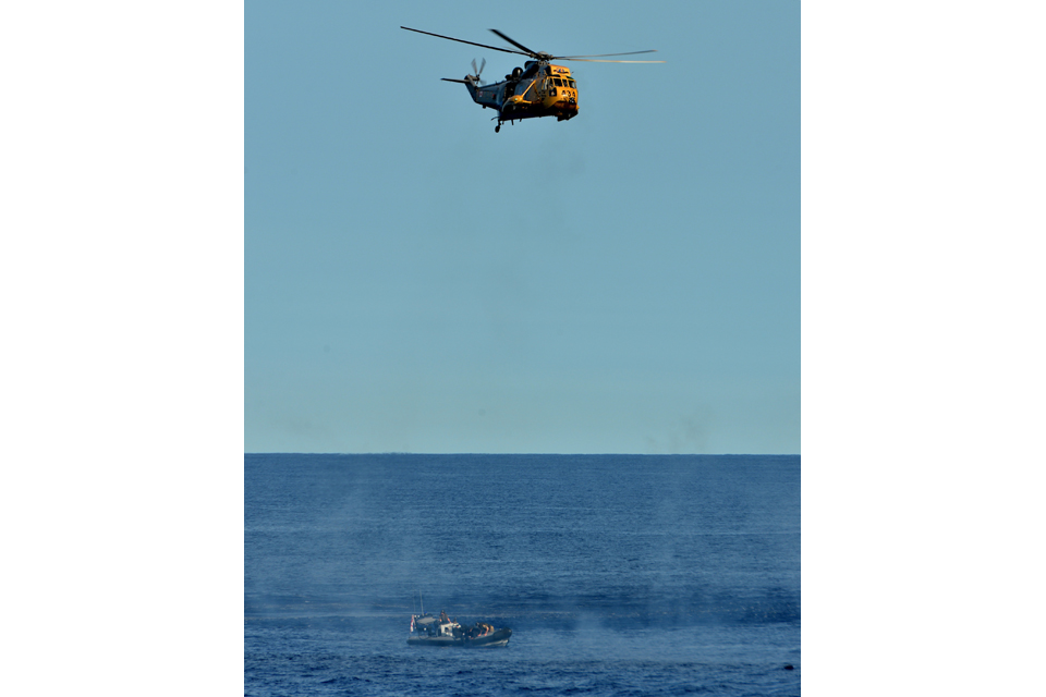 Sea King helicopter hovers over suspect speedboat