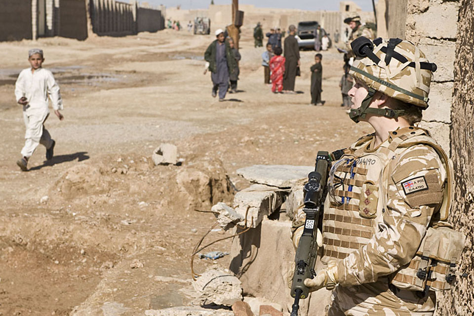 A British servicewoman in a CIMIC (Civil-Military Co-operation) role on patrol in Lashkar Gah, Helmand province, southern Afghanistan (stock image)
