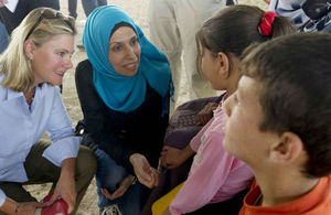 Secretary of State Justine Greening talks to Syrian refugees.