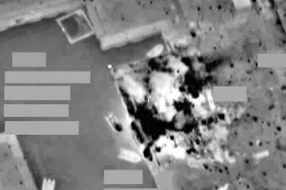 Targeting pod footage of an RAF missile strike on a Gaddafi-regime naval facility at Al Khums in northern Libya