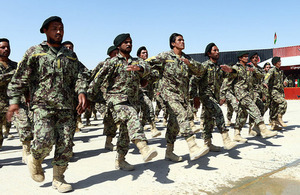 Afghan troops parade at the opening ceremony of the 215 Regional Corps Battle School [Picture: Sergeant Dan Bardsley, Crown copyright]