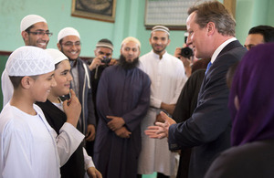 David Cameron meets members of a mosque in Manchester.