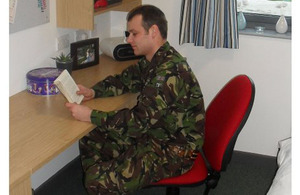 A soldier enjoying his new accommodation at Marne Barracks