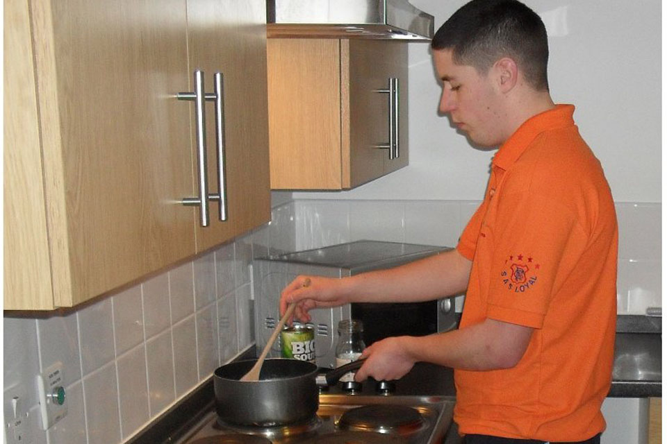 Cooking for one; a soldier uses the new facilities at Marne Barracks
