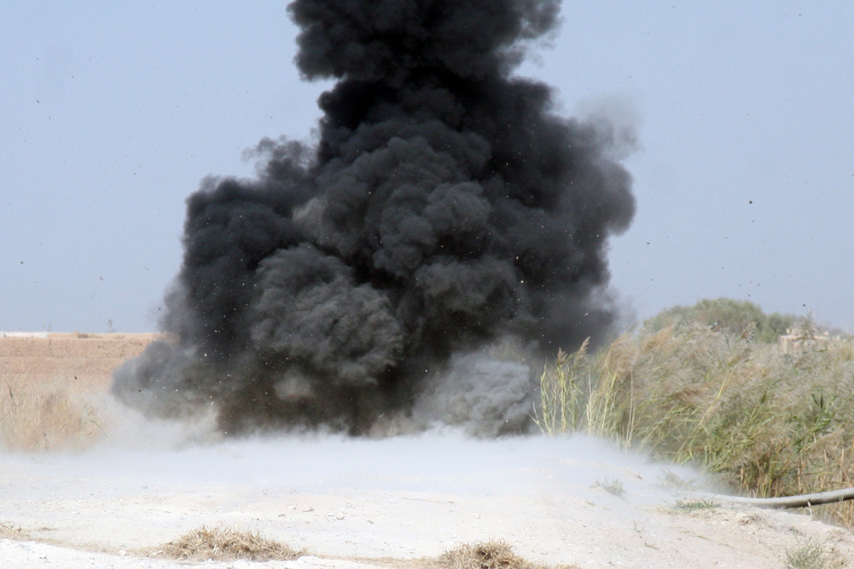 The controlled explosion of a roadside bomb