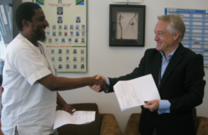 Head of DFID Tanzania, Mr Marshall Elliot shaking hands with Dr. Salim Abdulla