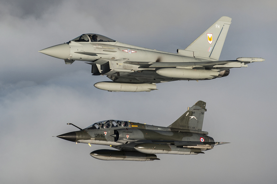 A Royal Air Force Typhoon (top) and a French Air Force Mirage 2000N