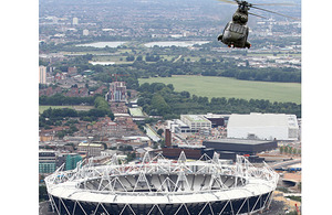 An RAF Puma flying over the 2012 Olympic Stadium. Puma and Lynx helicopters, operating from HMS Ocean, are likely to support airspace security during the Games