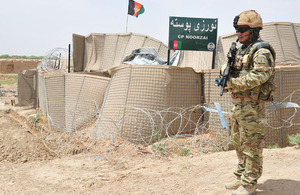 A Gurkha protects the gate at Checkpoint Noorzai during a visit