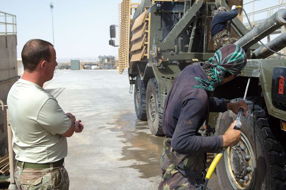 A military cargo vehicle is given a pressure wash