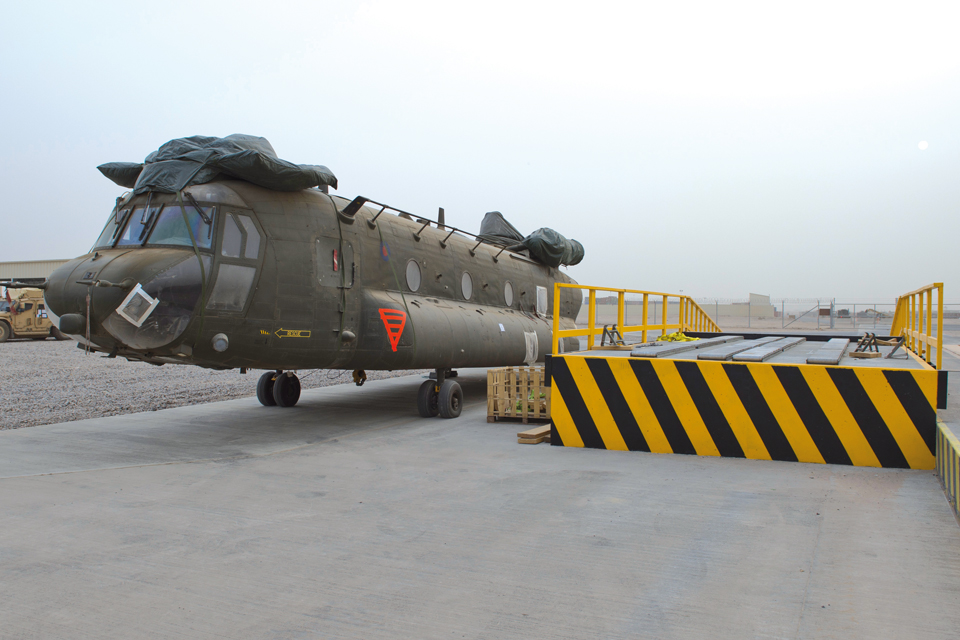 A Chinook helicopter is prepared for loading