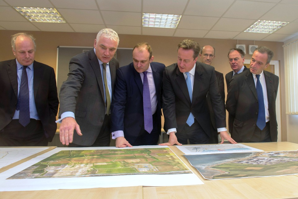 The Prime Minister and Edward Davey, Secretary of State for Energy, view plans for the new nuclear site at Hinkley, Somerset.