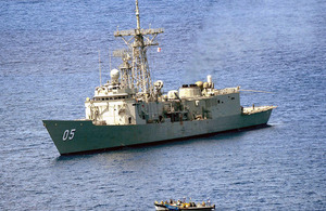 HMAS Melbourne closes in on a suspected pirate vessel [Picture: ABIS Jayson Tufrey, Commonwealth of Australia]