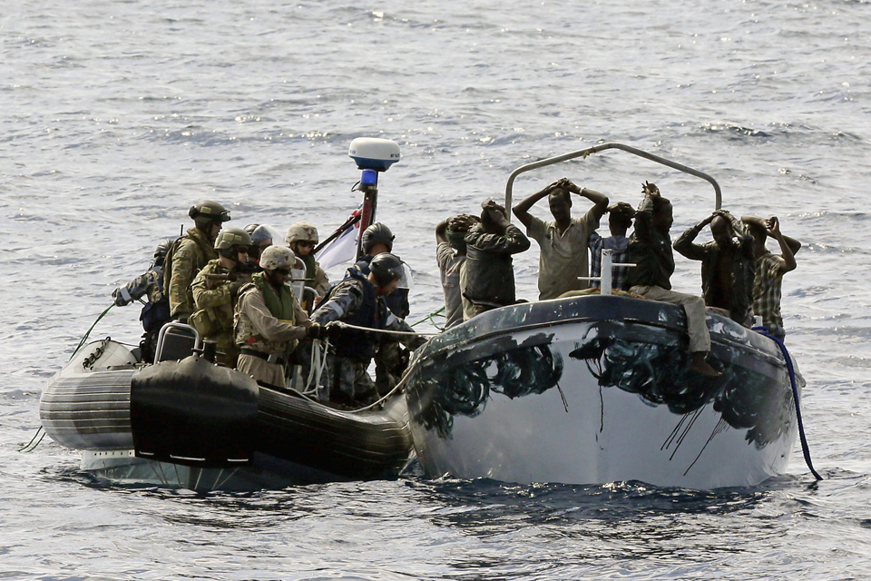 HMAS Melbourne's boarding party intercepts a suspected pirate boat