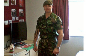 Lance Sergeant Dewi Ahearne in his new bedroom at Hounslow Barracks.