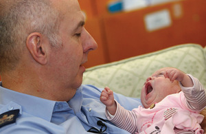 Warrant Officer Ian Phillips with baby Poppy Jane whose life he saved