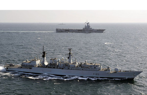HMS Cumberland (foreground) and French carrier Charles de Gaulle (background)
