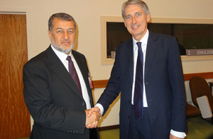 Afghan Defence Minister Bismillah Mohammadi (left) shakes hands with UK Defence Secretary Philip Hammond [Picture: Crown copyright]