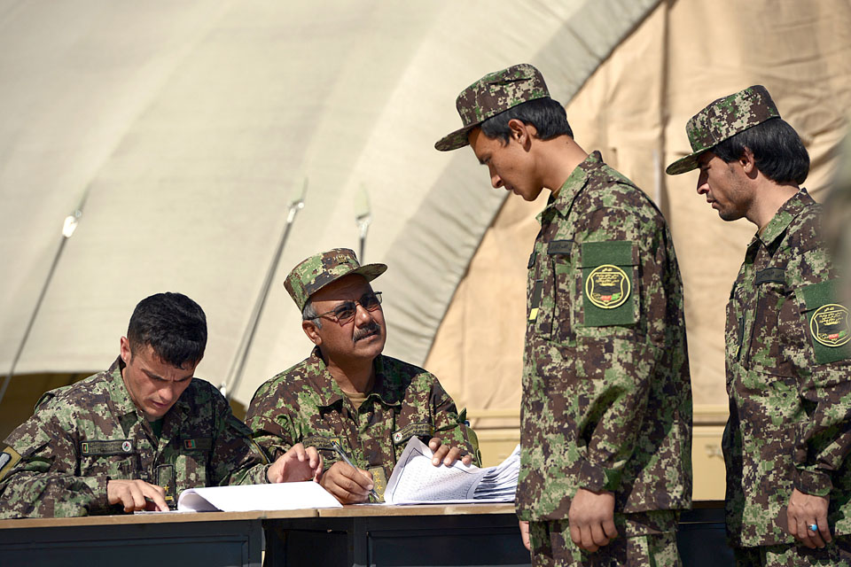 An officer cadet has his details checked during enrolment