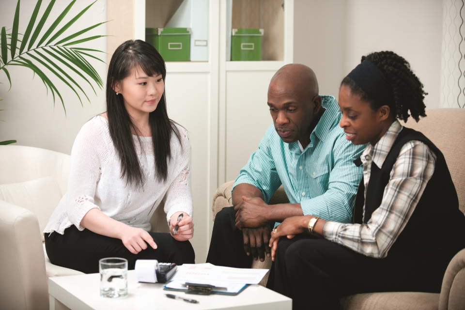 Group of three people looking over their energy bill