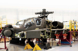 An Apache undergoes a thorough service at Wattisham