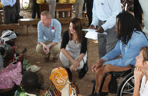 Photograph of Lynne Featherstone and Ade Adepitan in Uganda