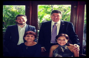 Ambassador Chris Campbell and Chevening scholar Juan Barrios with his grandmother and mother