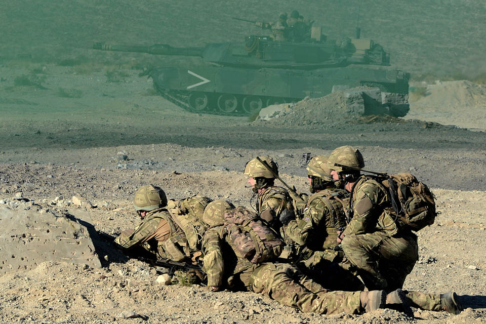 Royal Marines conducting a live fire attack