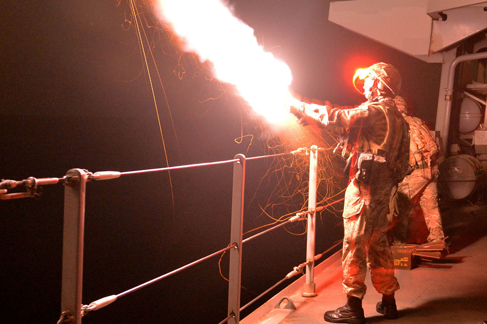 A flare is launched during a night shoot exercise