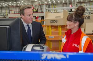 David Cameron meets a member of staff at ASOS.