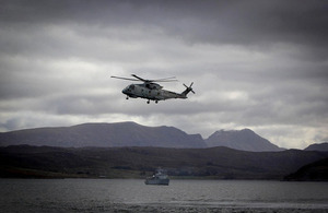 HMS Cattistock on Loch Ewe with a Merlin helicopter overhead during Exercise Joint Warrior [Picture: Crown copyright]