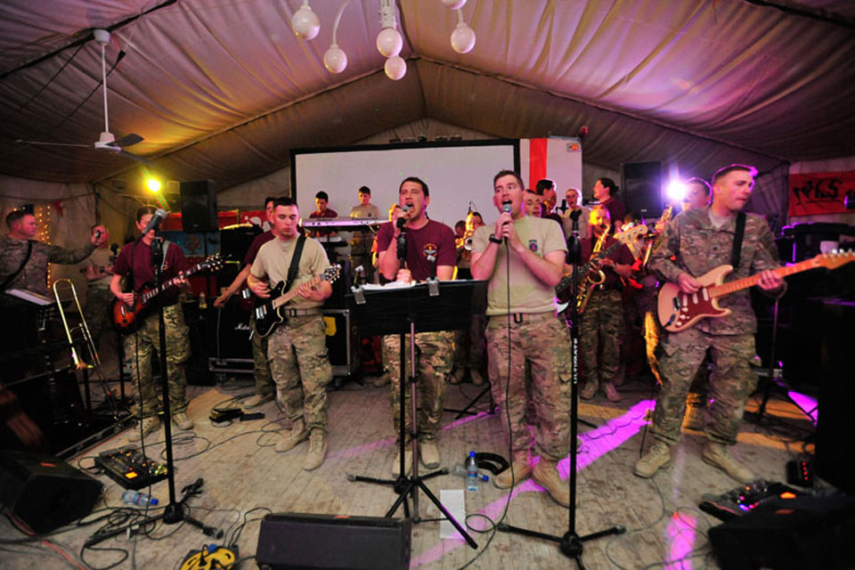 The Band of The Parachute Regiment performing as 'Ripcord' in a 'Battle of the Bands' at the 'Dutch Corner' (Dutch welfare facility) in Kandahar