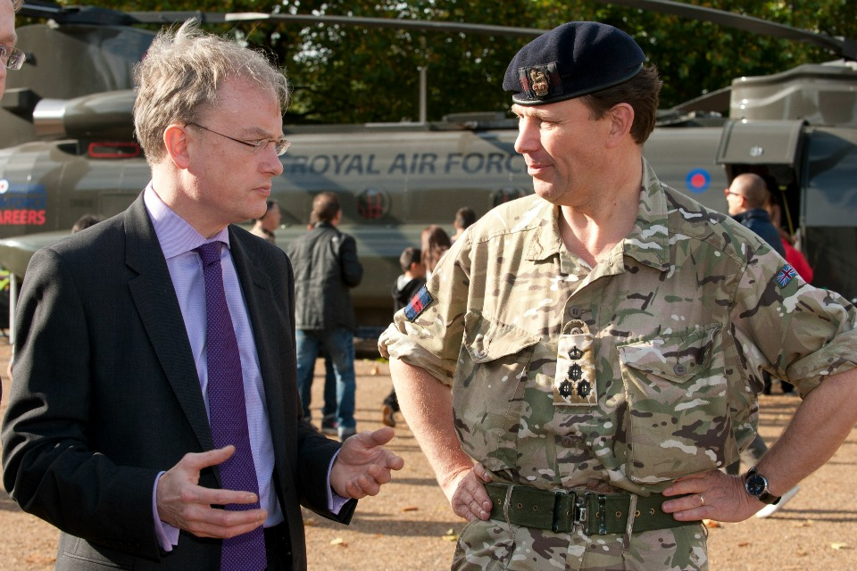 A civil servant talks to a member of the armed forces