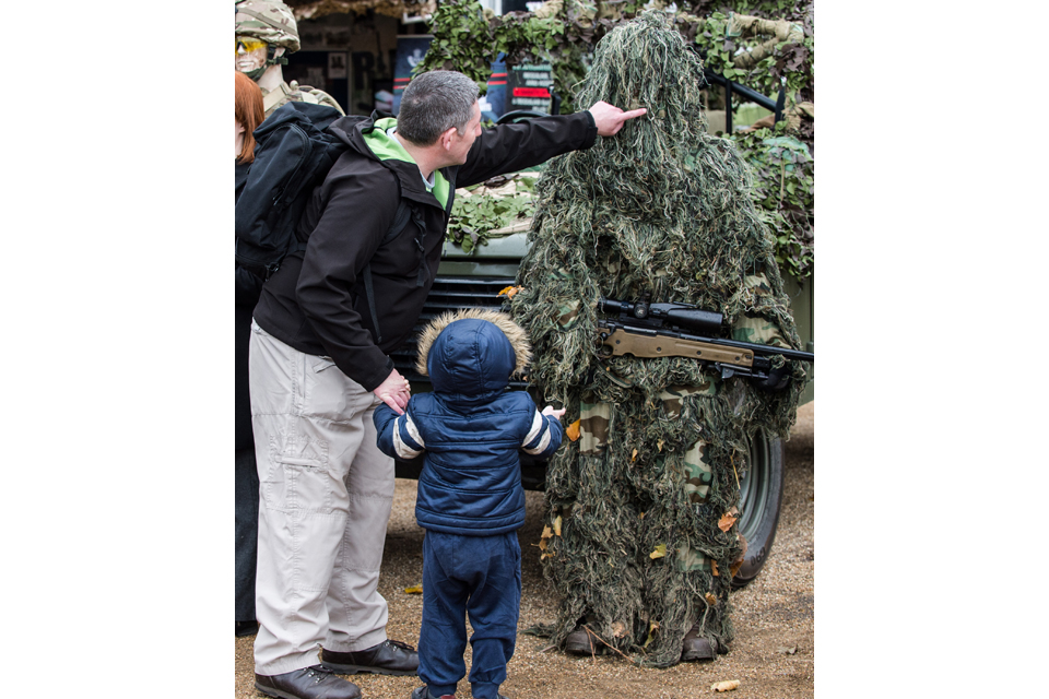 A father and son take a look at a British Army sniper