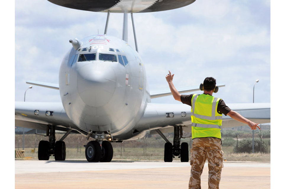 A Royal Air Force E-3D Sentry is marshalled out at Trapani, Sicily