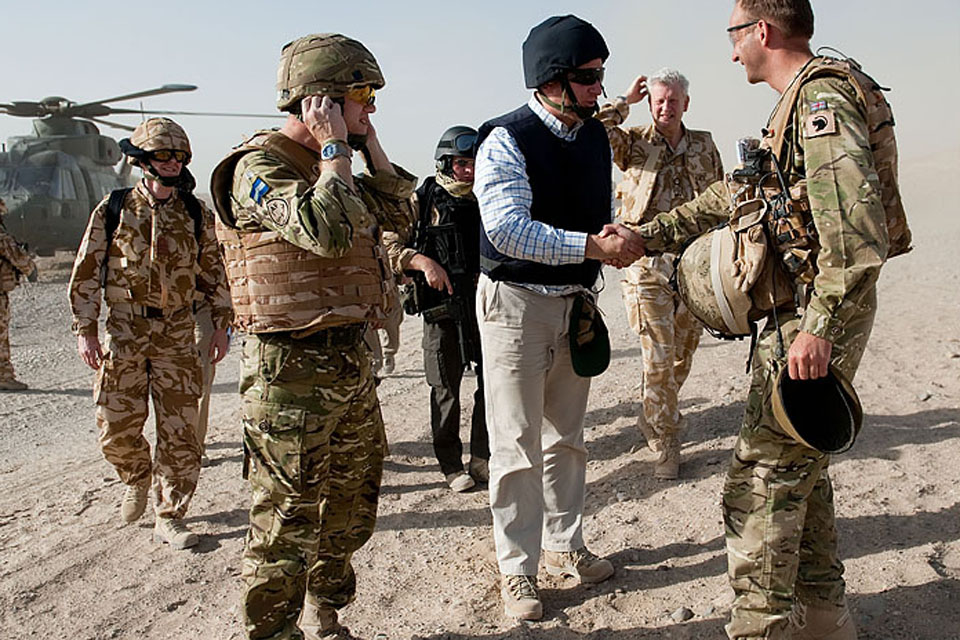 Armed Forces Minister Nick Harvey meets British troops in Helmand province, southern Afghanistan