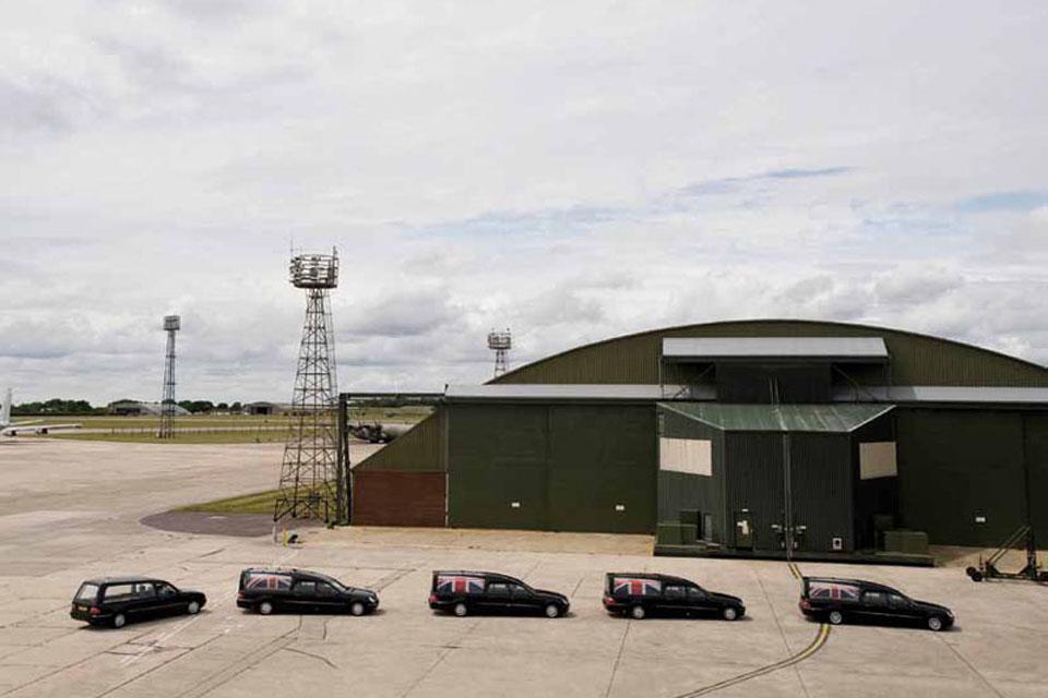 A funeral cortege leaves RAF Lyneham