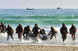 A joint forces beach assault [Picture: Leading Airman (Photographer) Arron Hoare, Crown copyright]