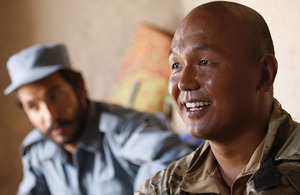 Sergeant Basanta Rai with a member of the Afghan Uniform Police