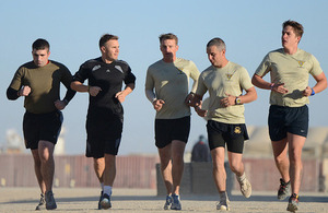 Singer-songwriter Gary Barlow joins British soldiers for a dawn run around Camp Bastion, Afghanistan [Picture: Sergeant Dan Bardsley, Crown copyright]